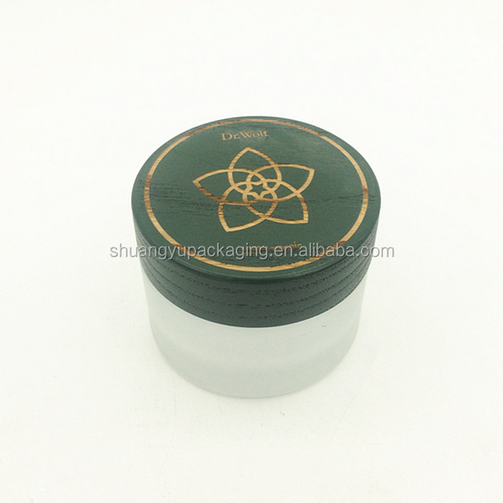 green color small clear frosting glass jar wooden lid