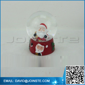 Snow globe with blowing snow