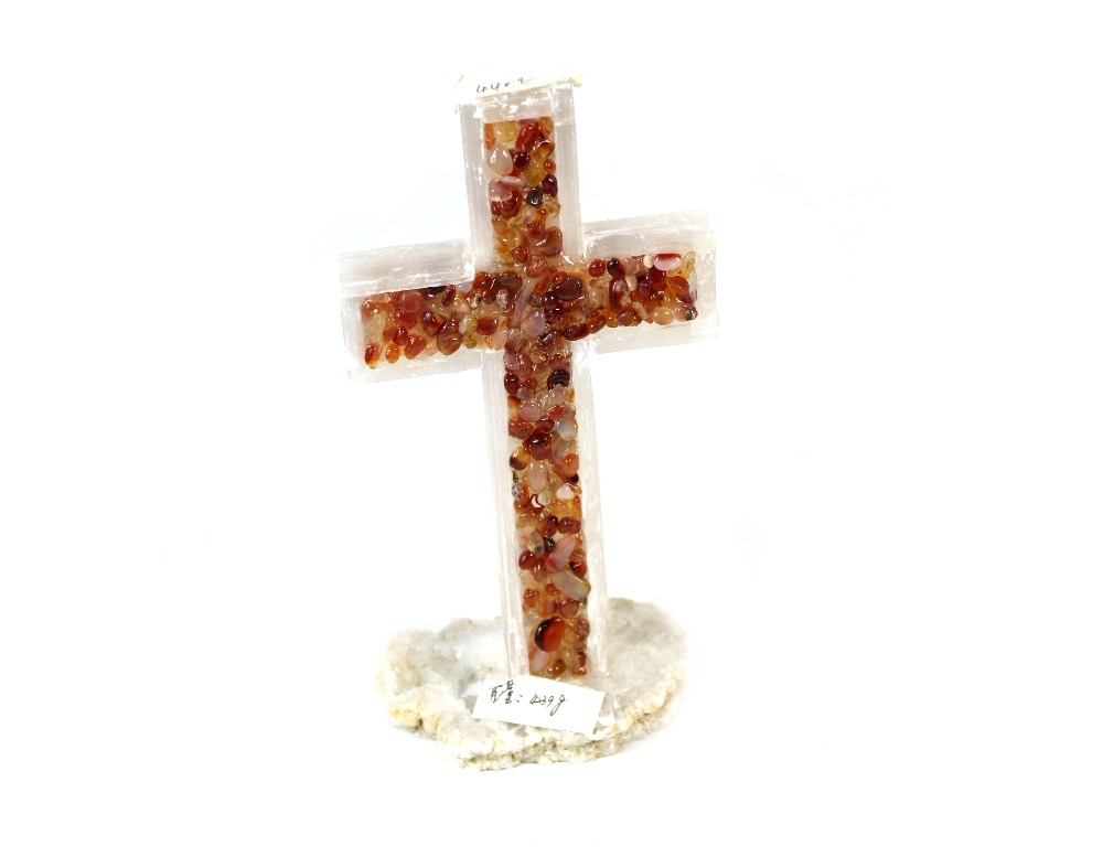 white selenite and polished carnelian crystal cross with geode slice base