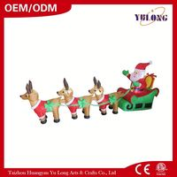 Giving gifts Santa Claus is sitting on a sled with his reindeer inflatable santa Inflatable Reindeer plastic cup making machine