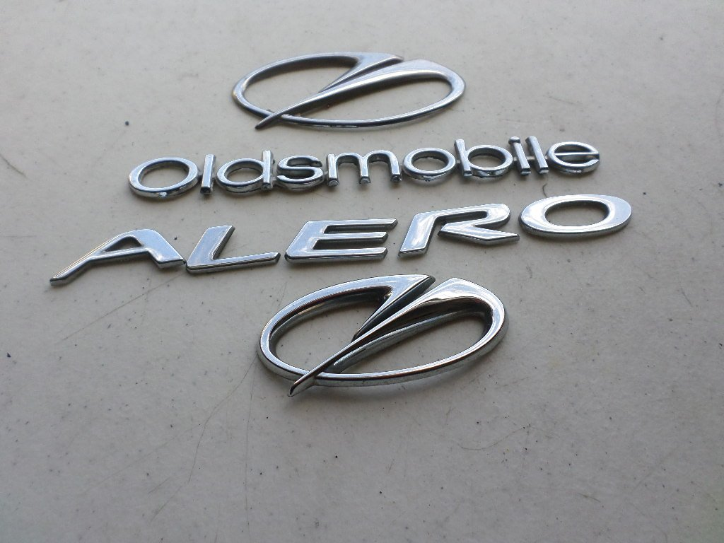 01-02 Oldsmobile Alero Front Grille Rear Trunk Chrome Nameplate Trim Emblem Logo Decal Set of 4