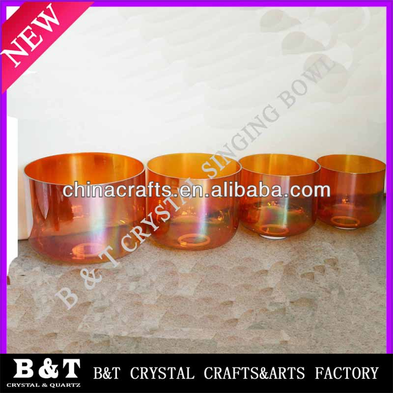 Orange chakra crystal singing bowl with music notes