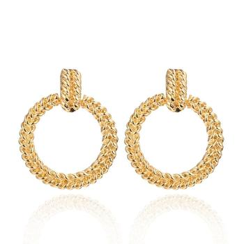 Individual geometric twist flower hollow earrings Simple hemp pattern road round temperament earrings female