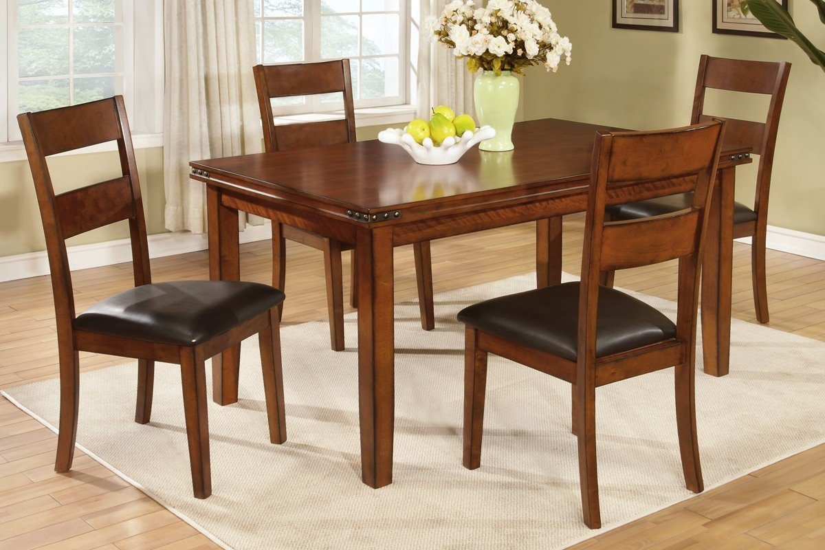 Dining room table set features tables and chairs covered in an antique medium oak finish giving it a country style design