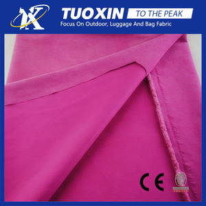 hot sale 100 polyester micro fiber twill peach skin fabric for business suit /jacket/wind coat