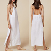 New white dress in low back and straight neck relaxed fit maxi long side slipt lady dress
