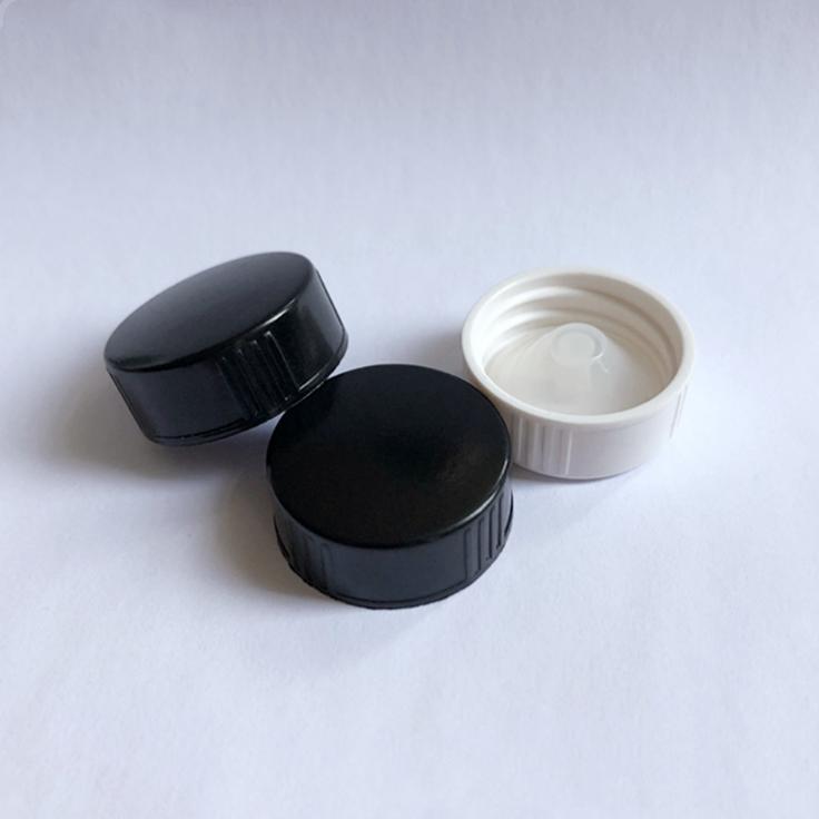 22/400 black phenolic bakelite UF cap with ribbed cap, boston bottle cap