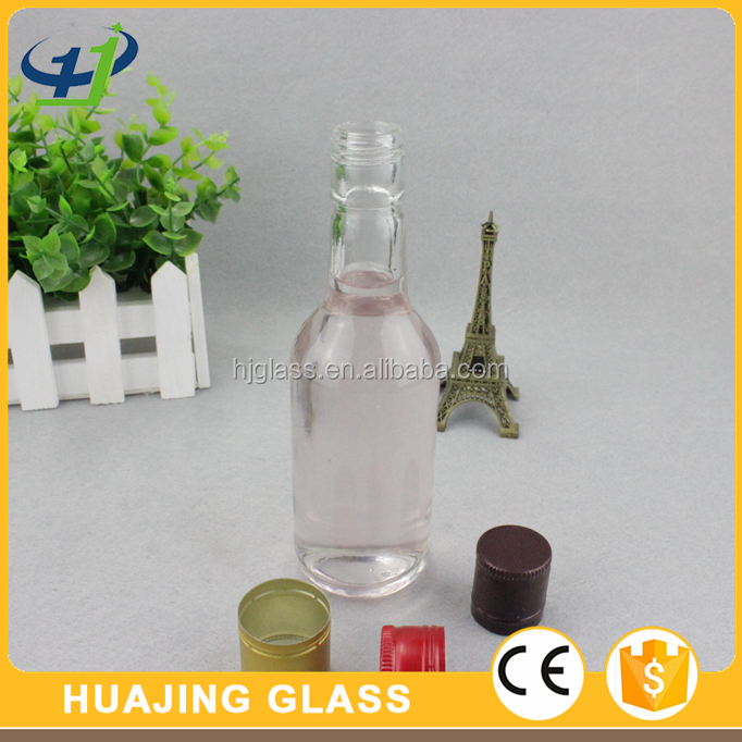 Silk printing 330ml glass used beer bottles with cap for sale