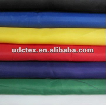 Poly taffeta fabric with cire finish