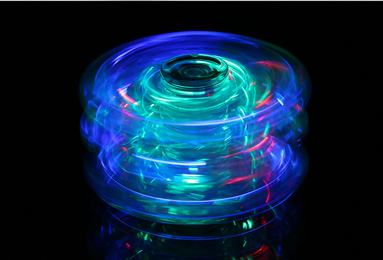 Yiwu wholesale Luminous finger Decompression toy Transparent Crystal Hand spinner Fingertip Gyro with LED light Switch