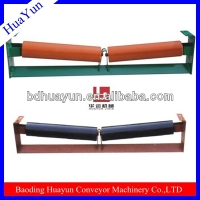 Tapered conveyor drive roller/welding machine shock absorbers