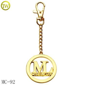 Custom made golden letter metal hang tags lady purse hollow brand logo metal plate