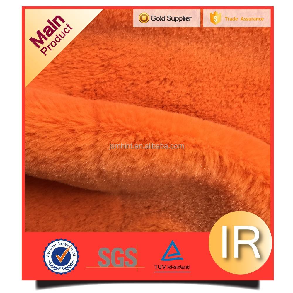 Solid color orange fake faux rabbit fur plush fabric