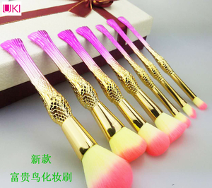 Factory whole sell 7 piece rich bird bodies shape gold hands gold tube makeup brush set