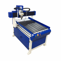 China JD 6060 Mini CNC Router Factory Price Automatic Tool Changer 3D Wood CNC Router 6090 4 Axis CNC Router