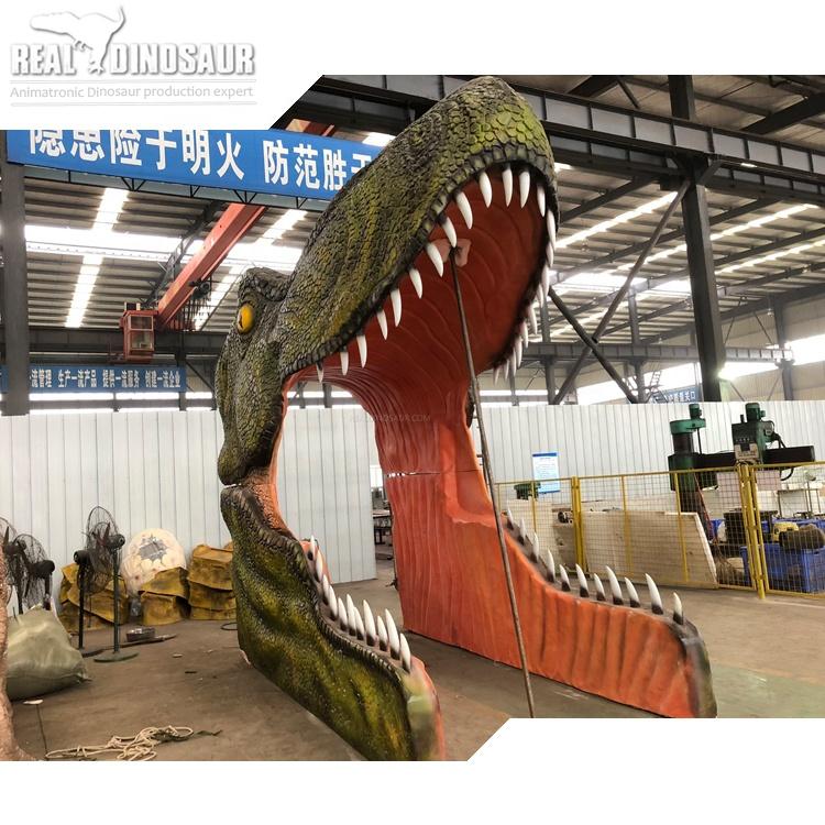 مدخل رأس ديناصور T-Rex من الألياف الزجاجية لبوابة حديقة الديناصورات