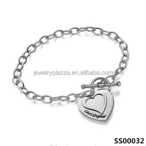 Custom sterling silver double heart charm bracelet with name
