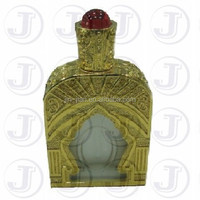 Grace Royal Palace Designed Arabian Perfume Oil Bottle with Glamorous Big Red Jewelry Decoration on the Twisted Cap Top