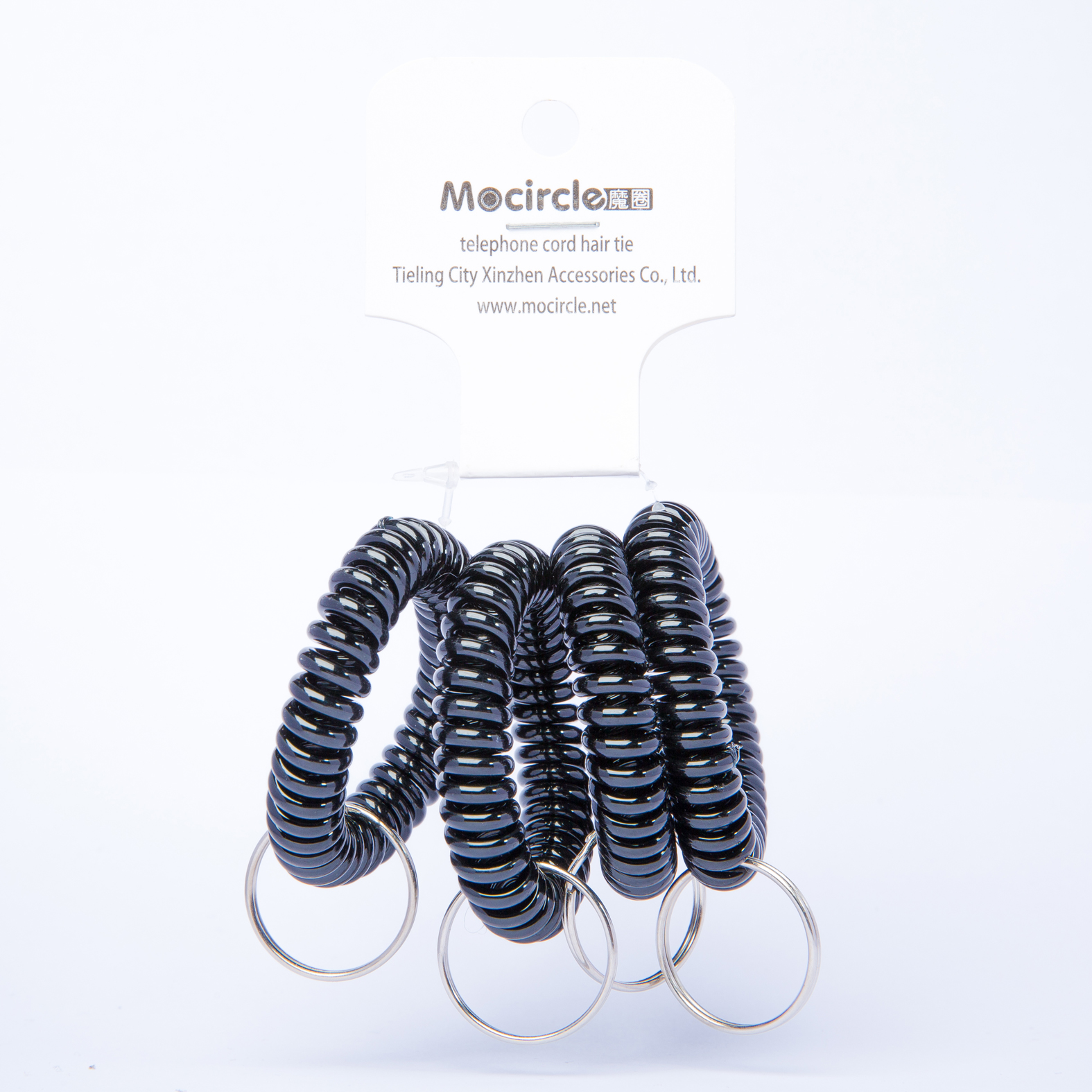 plastic black multi color coil spring keychain in tag packaging