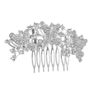 The bride's headdress is luxurious and full of butterfly rhinestone high grade bulk hair trim combs for decorative
