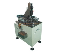 assembly machine for reed contact riveting