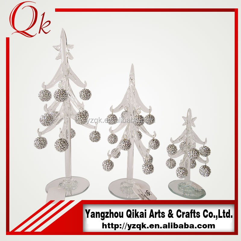 Silver hanging ornaments decorated clear glass christmas tree