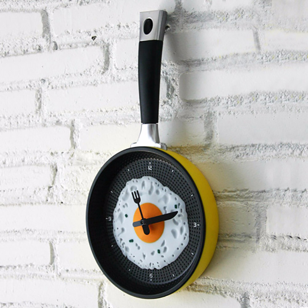 A wall clock as an element of the interior design in the kitchen