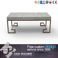 Iron frame center table with a concrete top