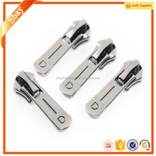 Supply reversible two sided key locking zipper sliders