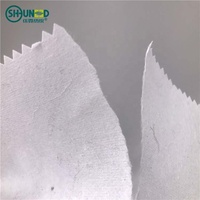 China hot sell tearaway backing paper for embroidery dress/100% cotton nonwoven interlining backing fabric for garment