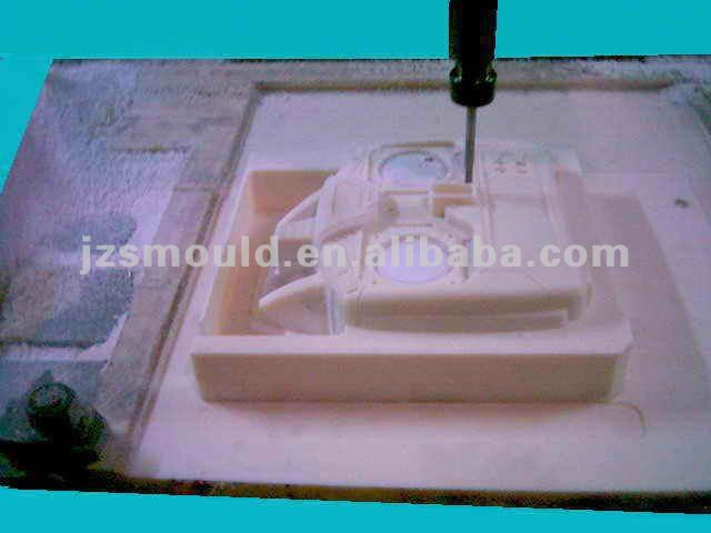 CNC machine producing plastic remote control phototype part
