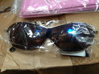 15 PALLETS OF SUNGLASS MAY BE 50,000 -70,000 PAIRS 85P EACH FOR QUICK SALE