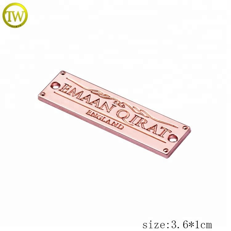 Eco-friendly clothing metal labels rose gold engraved logo jeans metal tag with holes