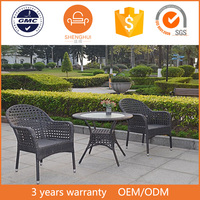 Fashion outdoor garden furniture 2 seats hollow woven black rattan/wicker coffee shop round rotating dining table and glass top