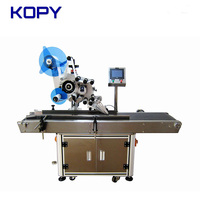 label applicator on plane surface flat container box bag labeling machine