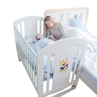 Professional height adjustable wooden baby crib supplier