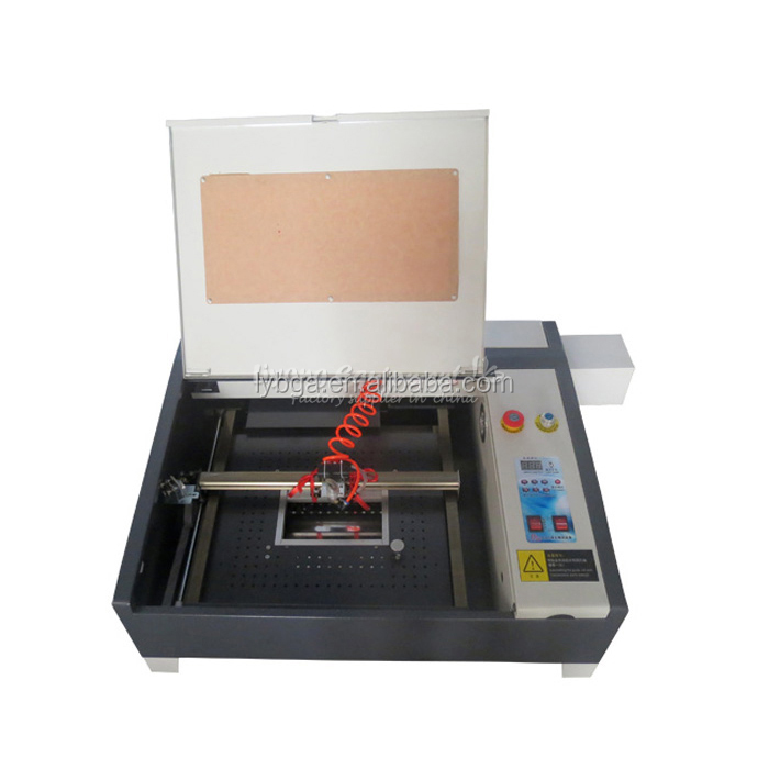 Latest LY 4040 CO2 Laser Engraving & cutting machine,50W,220V/110V,Super quality with all functions.laser CNC router