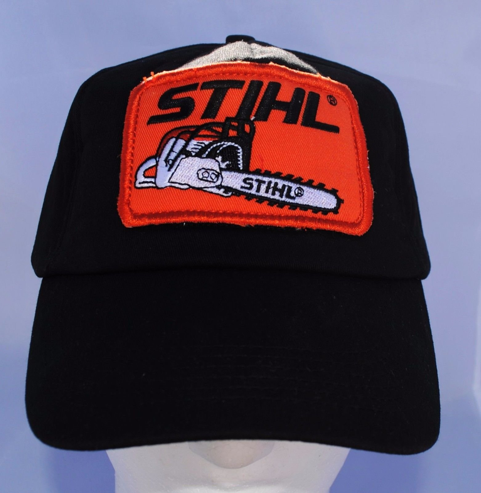 new concept 29211 5783a Get Quotations · Stihl Black Foam Trucker Truckers Hat   Cap With Orange  Patch