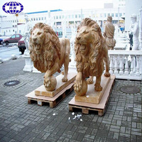 Beige antique marble lion statues for sale