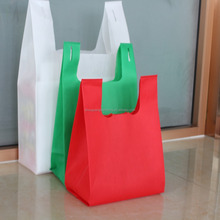 Cheap eco-friendly d cut /t shirt bag nonwoven printed shopping bags