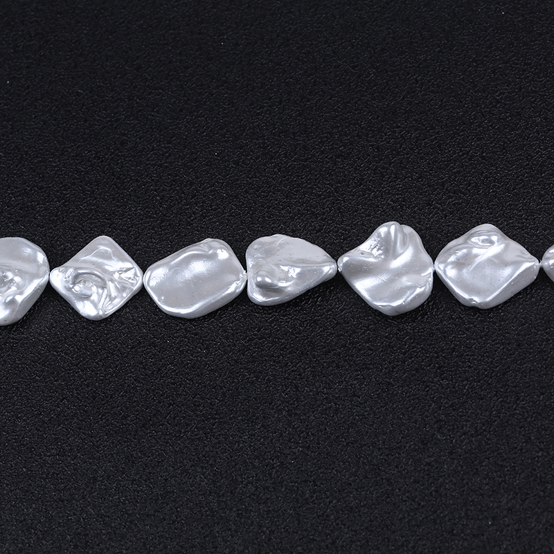 Large irregular shaped mother of pearl shell beads strand