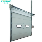 China cheap industrial overhead sectional loading door thermal insulated vertical lift cold room dock door with remote control
