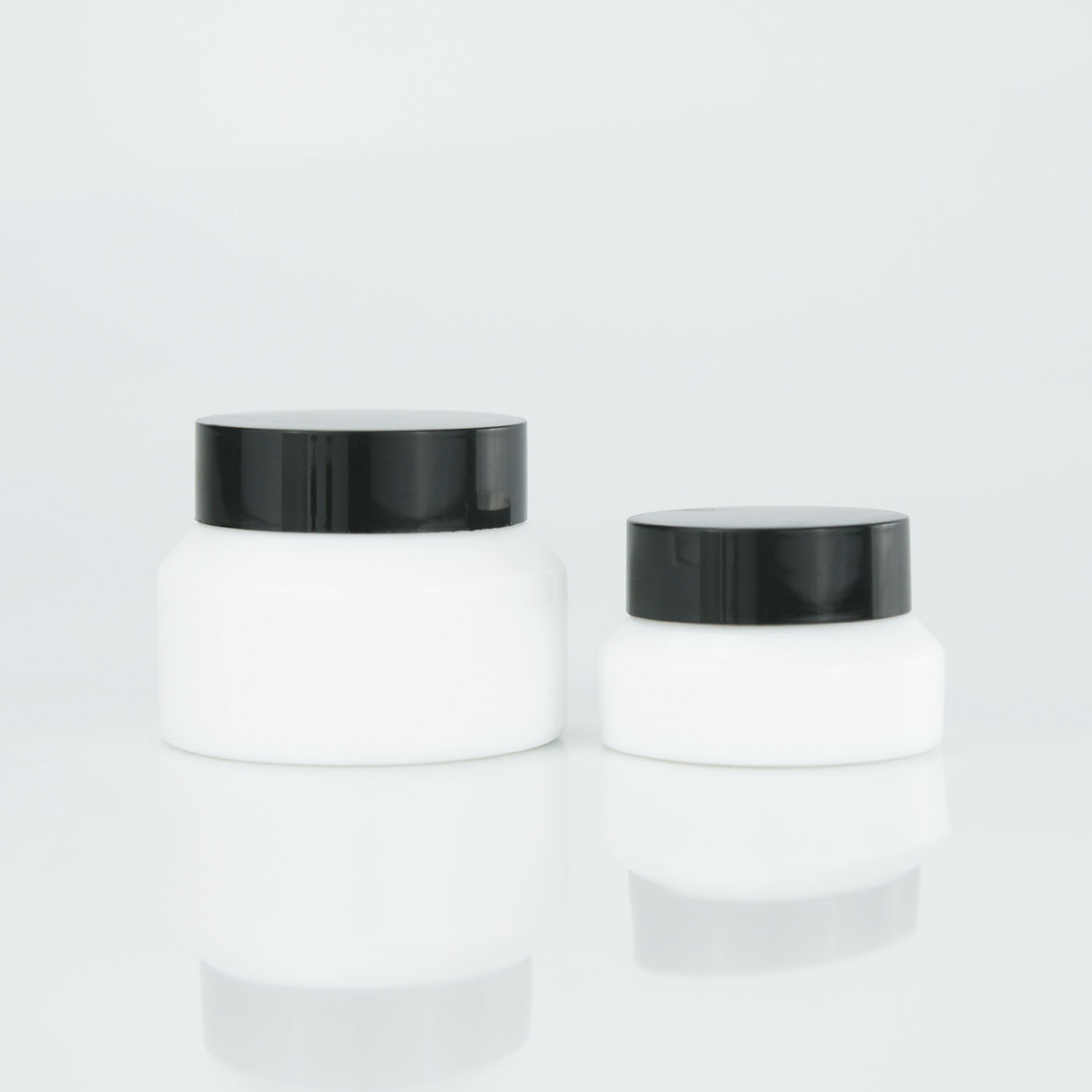 New arrival wholesale luxury slant shoulder white cosmetic cream glass bottles and jars