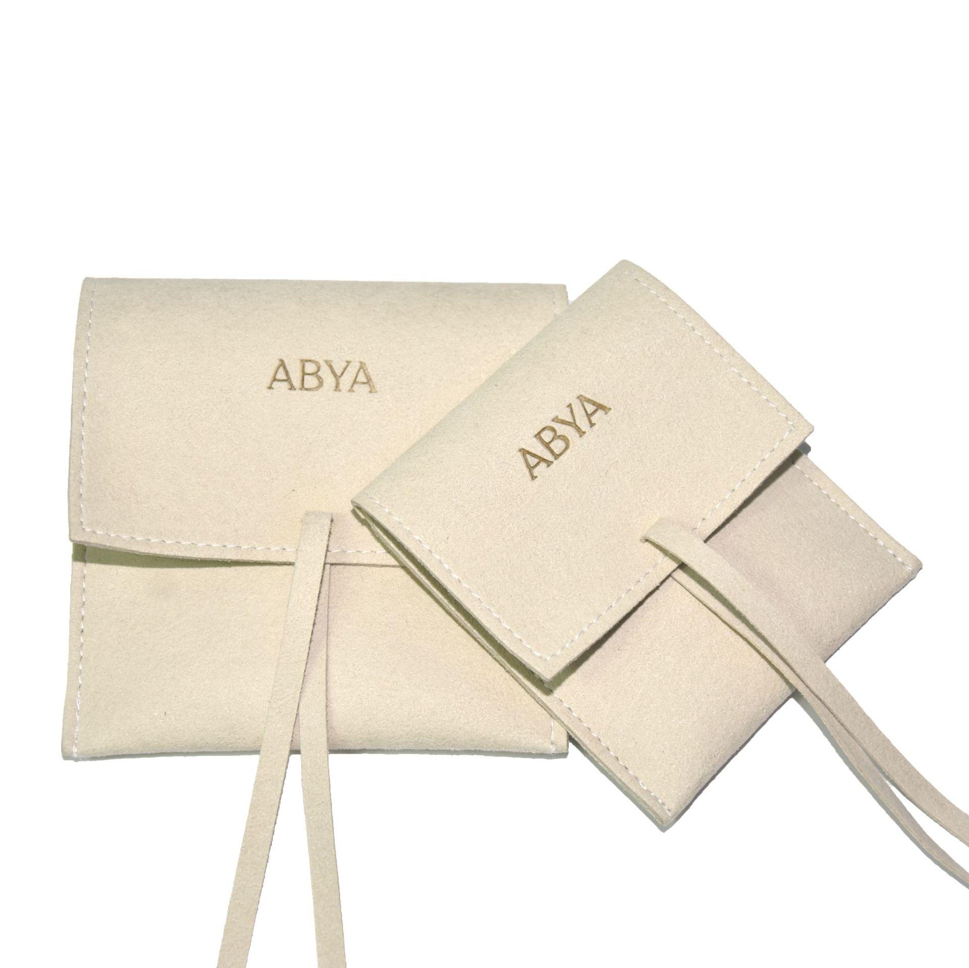 2020 مخصص منخفضة موك الفاخرة أضعاف صغيرة من جلد الغزال حقيبة هدايا مخملية الملمس المغلف الحقيبة حقيبة مجوهرات الأزياء مع الرباط والجلود