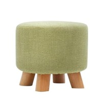 4 legged round wooden footstool with removable cover