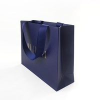 Wholesale Free Sample High Quality Fashion Luxury Die Cut Handle Paper Bag