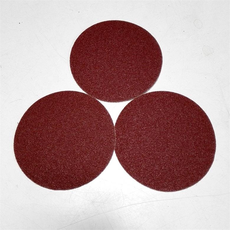 Hook and loop red sanding disc