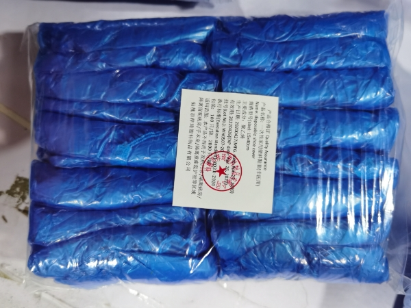Disposable waterproof and dustproof plastic PE shoe cover factory direct sale