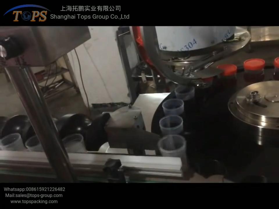 自動充填キャッピングラベリングマシン押してネジ蓋ボトルに