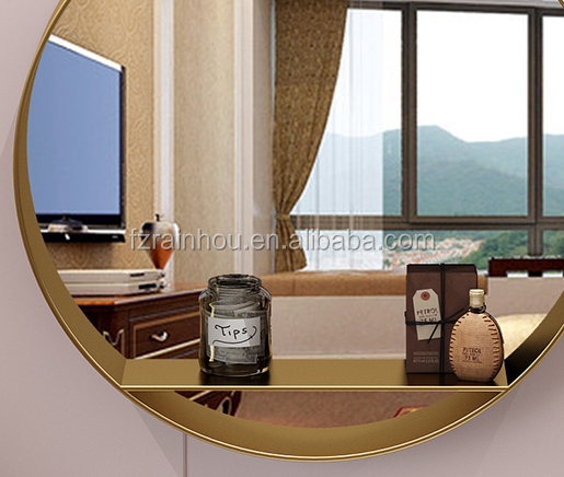 Round gold metal framed wall mirror with shelf  for bathroom